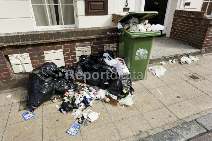 Rubbish and overspilling wheelie bins on the pavement in central Southampton because they have not been emptied during a strike by council refuse collectors. - Paul Carter - 2011-08-05