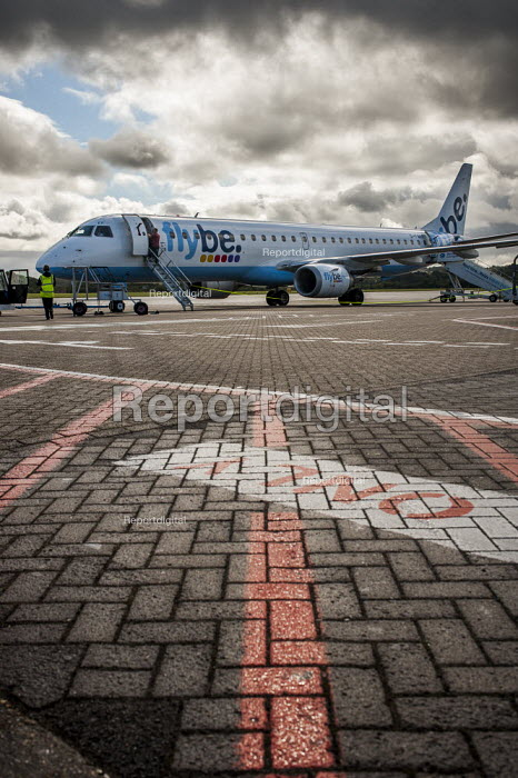 A FlyBe Embraer 195 passenger jet on its stand on the ground. Southampton International Airport. - Paul Carter - 2012-09-14