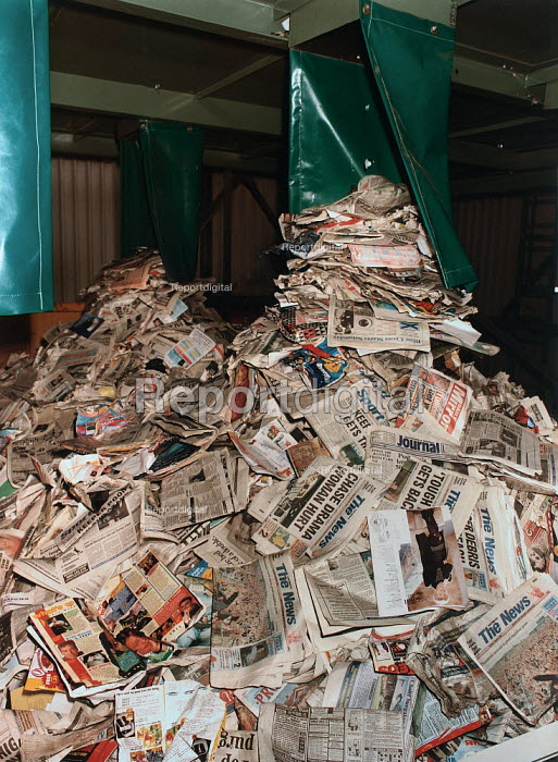 A pile of newspapers and magazines in a skip ready for recycling. - Paul Carter - 1994-08-26