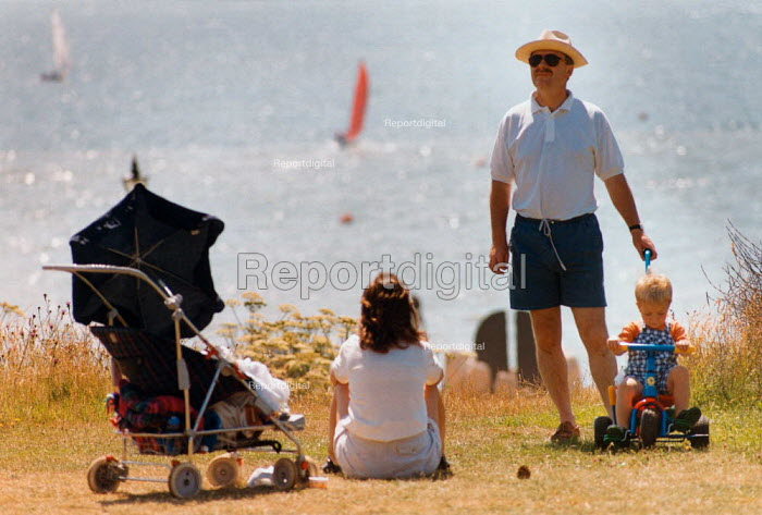 Mother and father with their small children enjoying a day by the sea. - Paul Carter - 1996-07-20