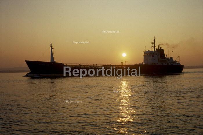 Cargo ship on still water at sunset. - Paul Carter - 2001-04-25
