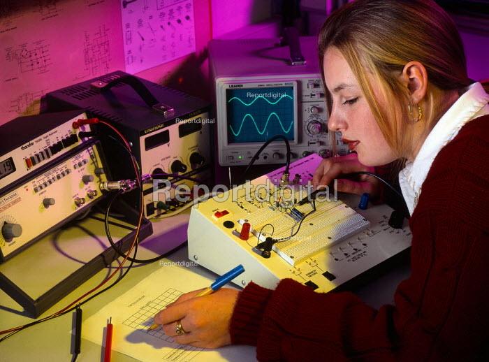 Student testing an electrical circuit - Paul Carter - 2001-04-25