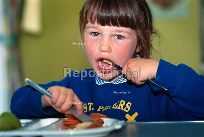 Young schoolgirl eating her dinner. - Paul Carter - 1997-07-05