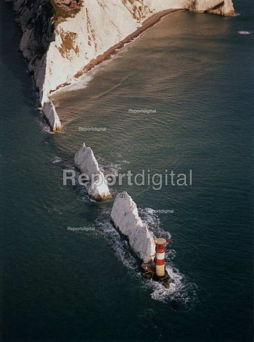 Aerial view cf The Needles, on the west coast of The Isle of Wight. Warm afternoon sun is turning the chalk cliffs yellow. - Paul Carter - 1996-10-04