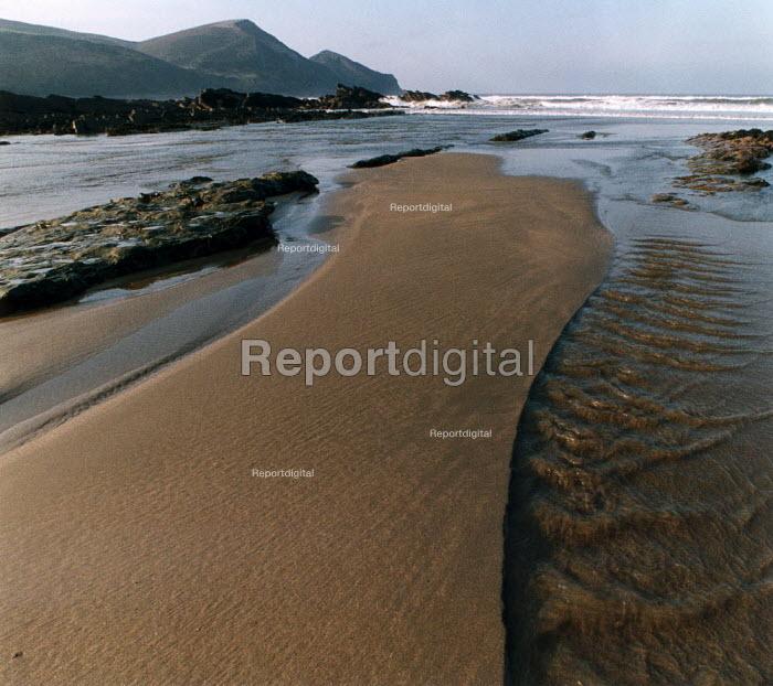 Small river flows across a sandy beach into the sea. - Paul Carter - 1990-08-01