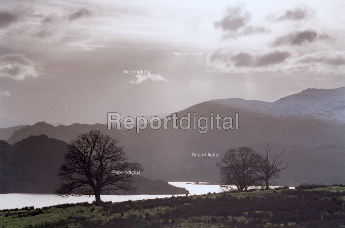 Ullswater, with surrounding hills covered by snow and mist. - Paul Carter - 2000-12-25