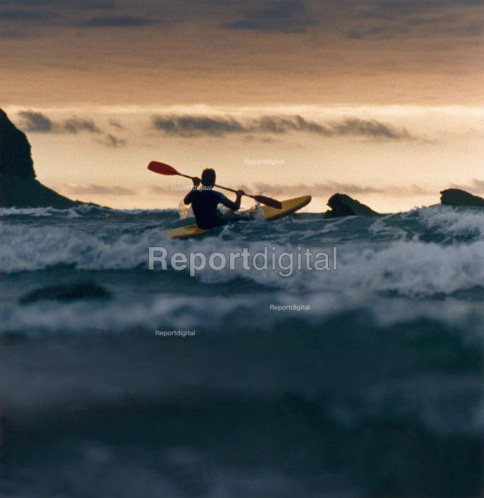 Lone canoeist paddling out to sea. - Paul Carter - 1990-08-01