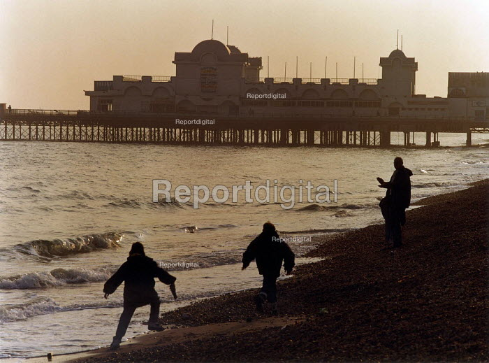 Children playing on the beach at sunset with South Parade Pier in the background. - Paul Carter - 1996-04-11