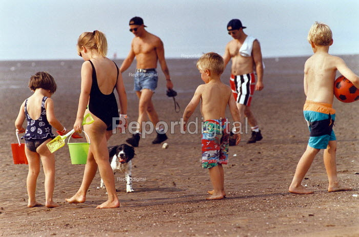 Children and adults on a sandy beach. - Paul Carter - 1995-08-01