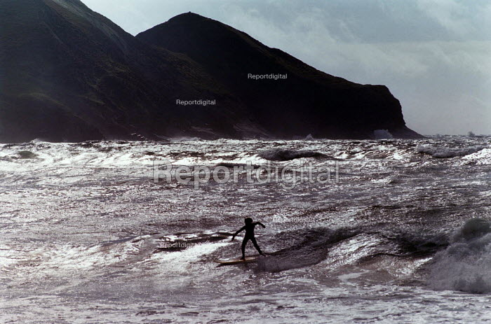 Surfer riding the waves. - Paul Carter - 1998-08-10