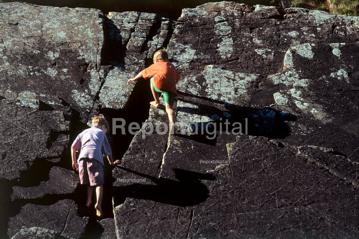 Children playing on a rock face. Crackington Haven, North Cornwall. - Paul Carter - 1997-08-21