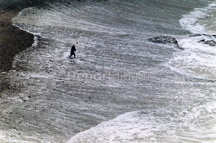 Man throwing stones into the surf, Crackington Haven, North Cornwall. - Paul Carter - 1989-12-22