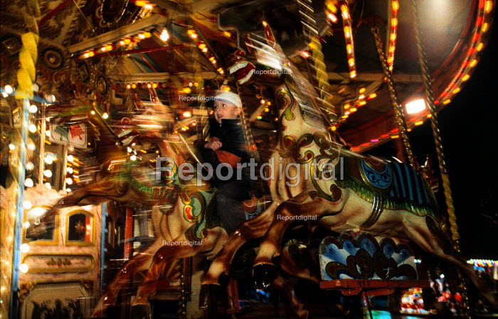 Riding on a merry-go-round. Part of Christmas celebrations. - Paul Carter - 1998-12-15