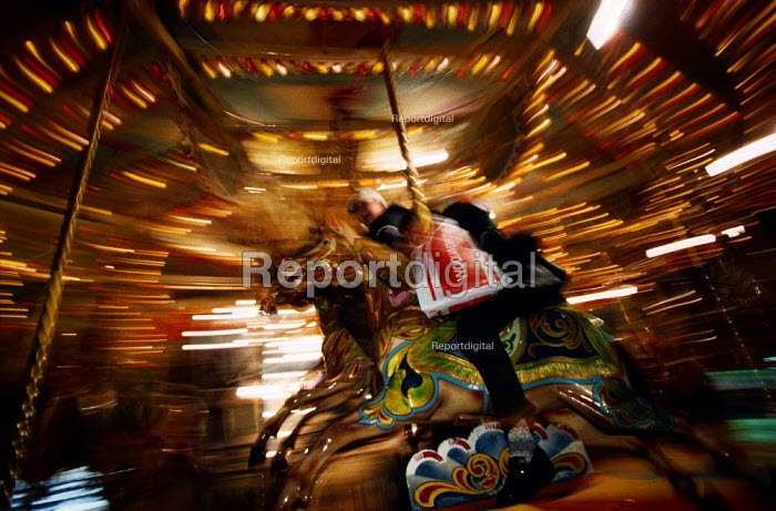 Riding on a merry-go-round. Part of Christmas celebrations in a shopping precinct. - Paul Carter - 1998-12-15
