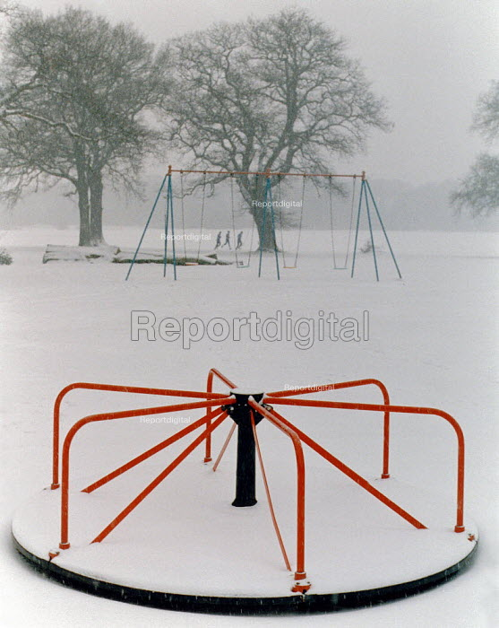Roundabout and joggers in the snow. - Paul Carter - 1984-12-28