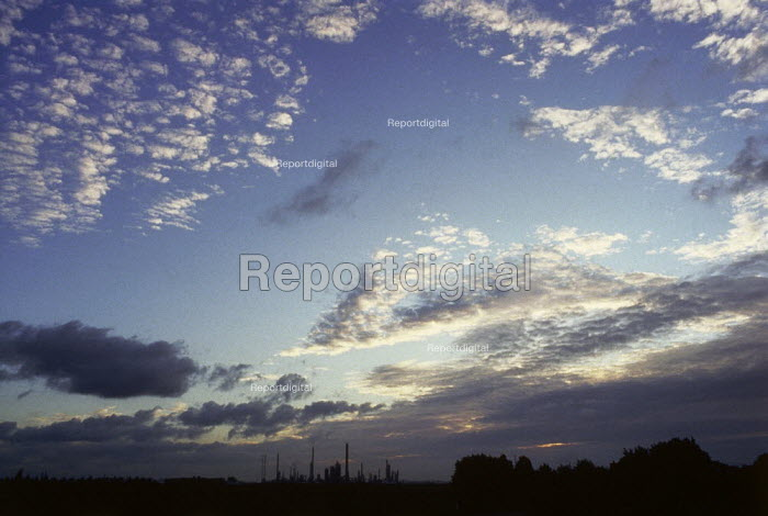 Dramatic sky with oil refinery towers on the horizon. - Paul Carter - 2001-07-21