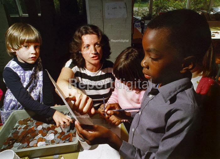 Teacher helping children learn about money. - Paul Carter - 1987-10-05