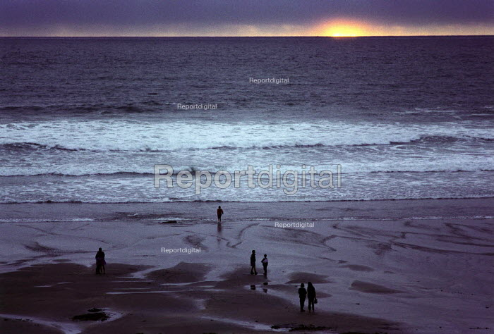 People watching the sunset on the beach. Crackington Haven, North Cornwall. - Paul Carter - 1992-08-01