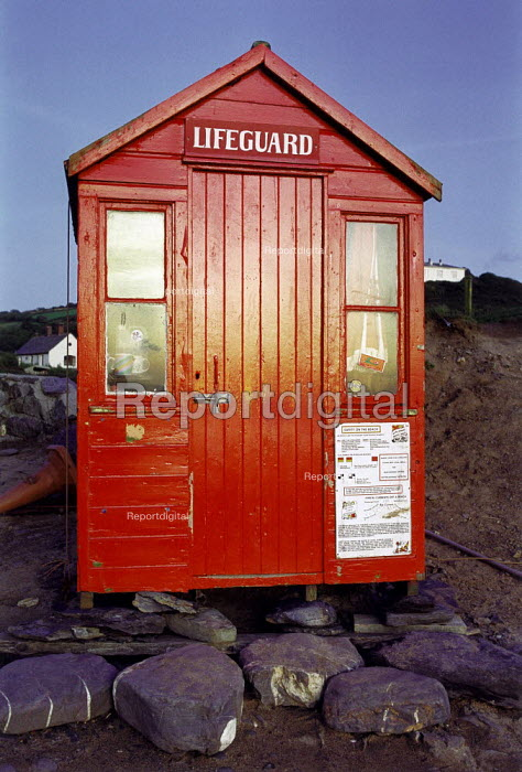 Bright red lifeguard hut on the beach. Crackington Haven, North Cornwall. - Paul Carter - 1992-08-01