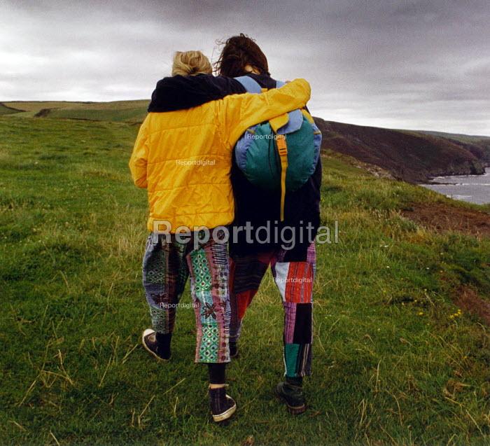 Two teenage girls seen from behind, walking along the North Cornwall coastal path. Near Crackington Haven. - Paul Carter - 1993-08-01