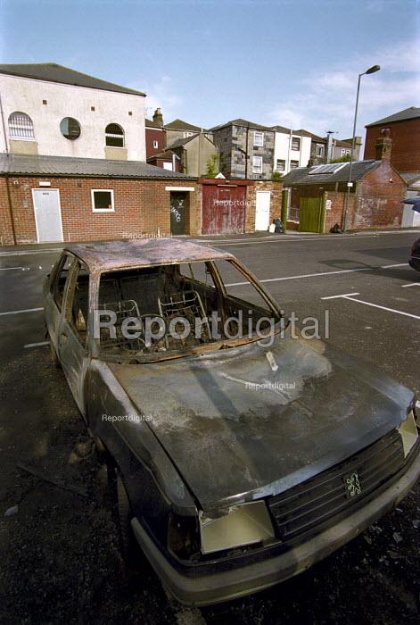 Burnt out car in an inner city car park. - Paul Carter - 2001-06-05