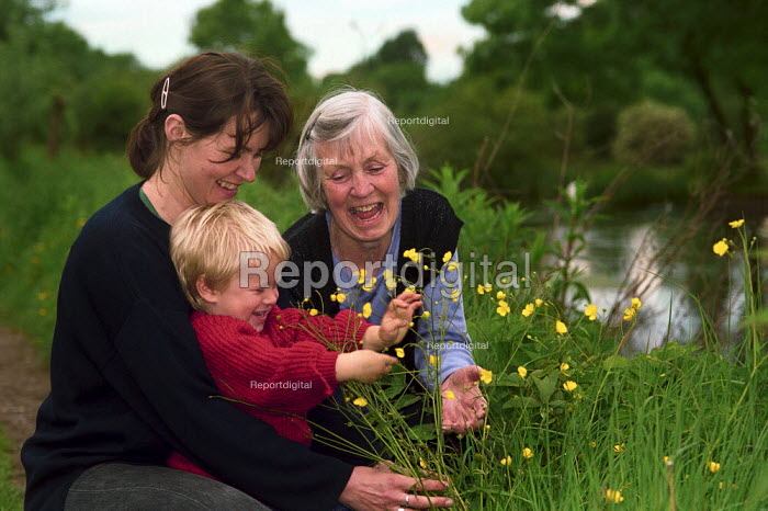 Family enjoying wild flowers along the banks of the River Itchen. - Paul Carter - 2000-05-21