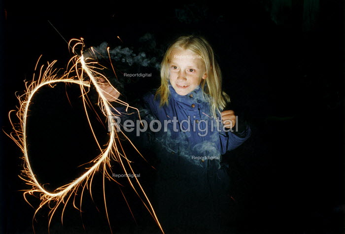 Young girl holding a sparkler. - Paul Carter - 1988-11-05