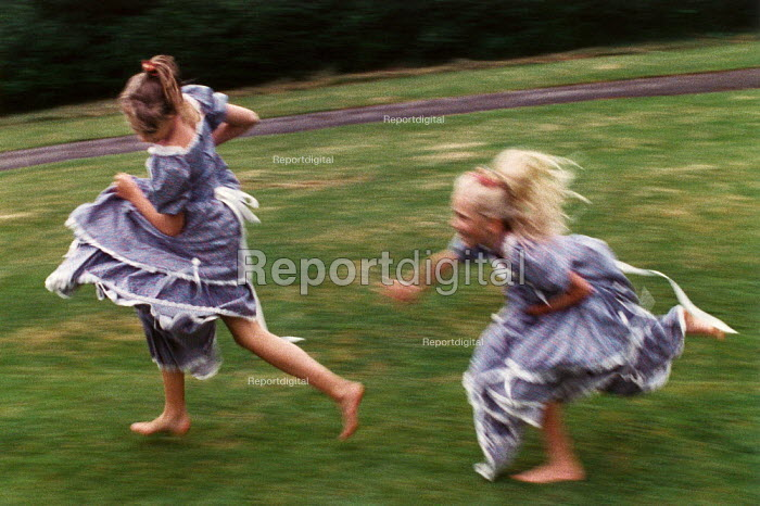 Two teenage girls playing chase. - Paul Carter - 1989-05-01