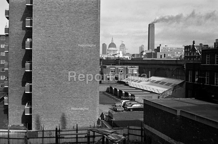 View of Bankside Power Station when it was still operational, 1973. It is now the Tate Modern art gallery. Blackfriars Square council houses on the left. St Pauls cathedral on the horizon. - Paul Carter - 1973-11-19