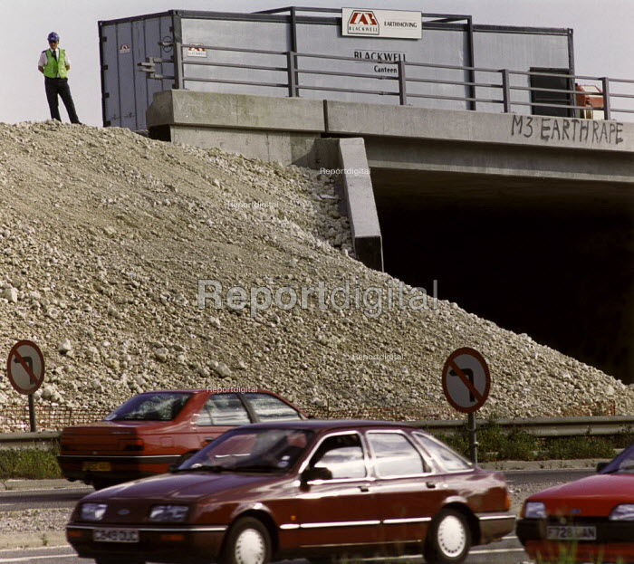 Cars passing roadworks during the construction of the M3 Winchester by-pass. Being watched by a security guard. - Paul Carter - 1993-08-06