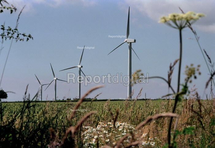Group of windmill, CumbriaThis wind farm generates enough power for 2,000 homes, saving 8,530 tonnes of Greenhouse gases a year. - Paul Carter - 2000-07-17