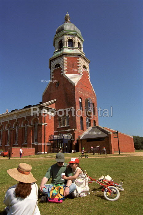 Family sitting on the grass in front of the Chapel Museum, Royal Victoria Country Park, Southampton. - Paul Carter - 1996-07-20