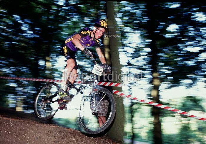 Riding down a steep hill in the woods during a mountain bike race. - Paul Carter - 1996-08-04