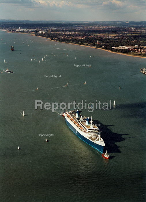 Aerial view of the NSL cruise ship Norway being towed by red tugs along Southampton Water - Paul Carter - 1996-10-04