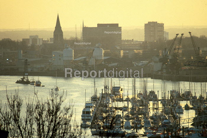 View over the River Itchen, Southampton, with industrial area on one side and moored yachts on the other. Taken at dusk. - Paul Carter - 2002-06-19