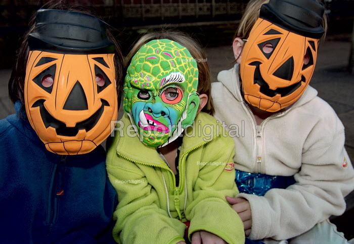 Children wearing plastic Halloween Masks. - Paul Carter - 1999-10-31