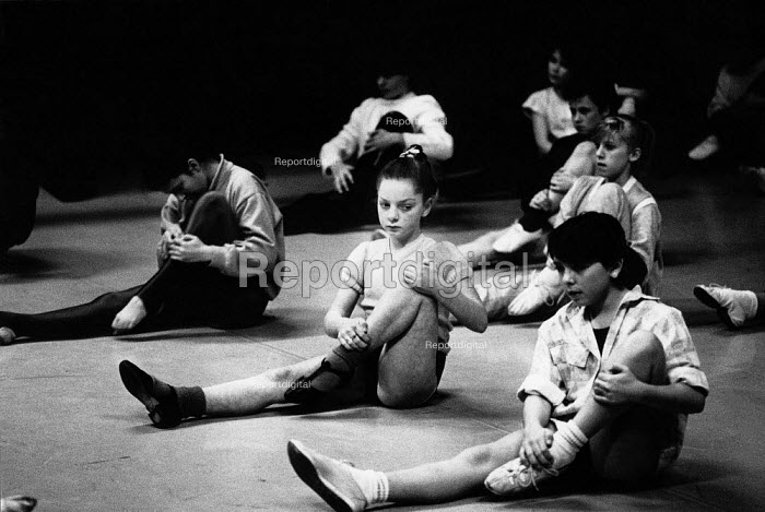 Children stretching during the warm up of their dance class. - Paul Carter - 1999-09-18