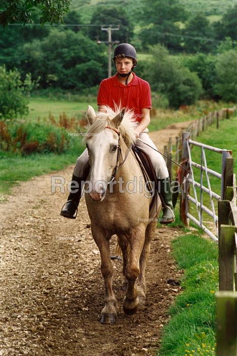 Boy riding a horse. - Paul Carter - 1988-08-01