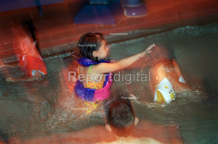 Young girl, playing in the learner's swimming pool. - Paul Carter - 2002-08-11
