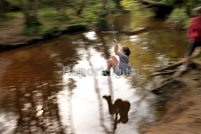 Young girl playing on a rope swing in The New Forest. - Paul Carter - 1993-05-22