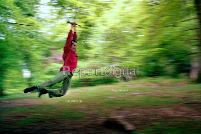 Playing on a rope swing in The New Forest. - Paul Carter - 2002-05-20