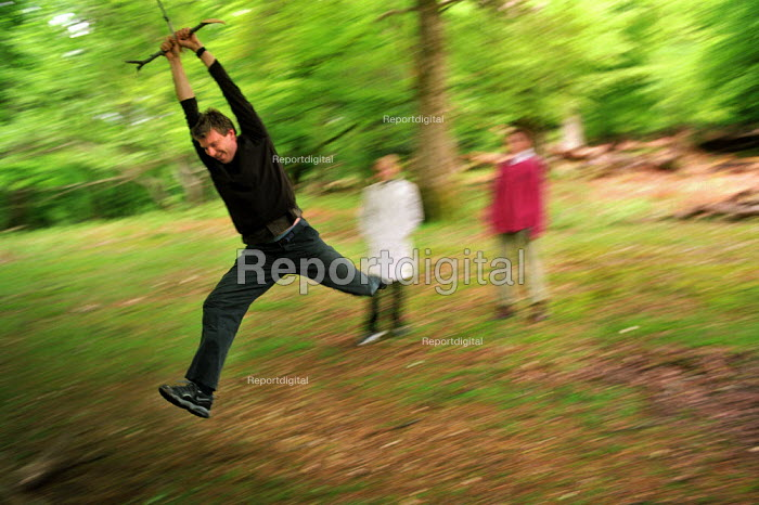 Friends playing on a rope swing in The New Forest. - Paul Carter - 2002-05-20