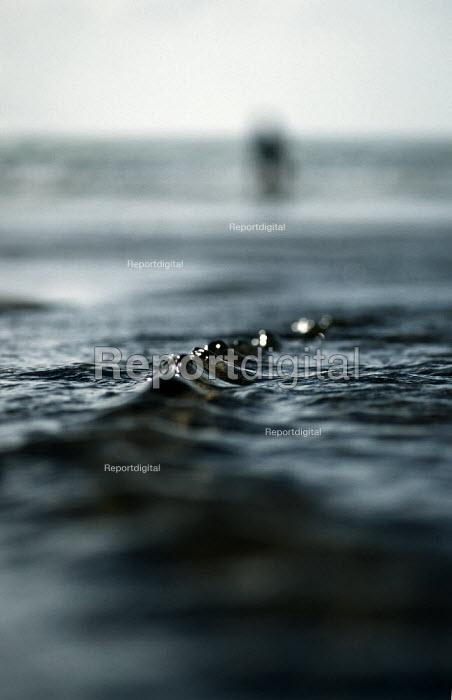 Small waves ripple on a sandy beach. Crackington Haven, Cornwall. - Paul Carter - 1997-08-21
