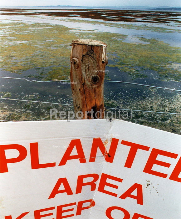Sign on a fence post in a conservation area. - Paul Carter - 1994-05-14