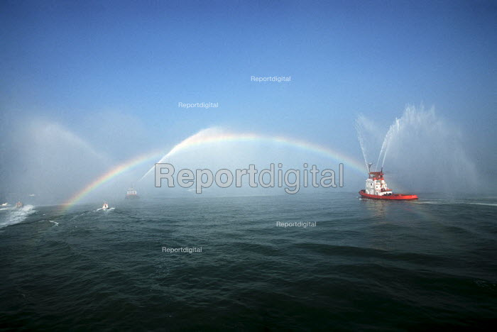 Fireboat spraying jets of water, creating a rainbow. - Paul Carter - 1997-09-20
