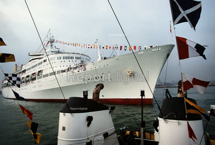 The Canberra covered in bunting - celebrations that marked the end of the ship's last voyage. - Paul Carter - 1997-09-20