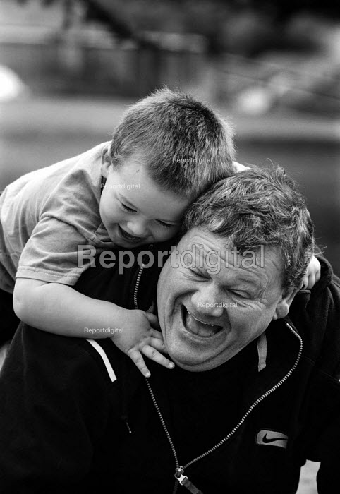 Father and son playing. - Paul Carter - 2001-09-13