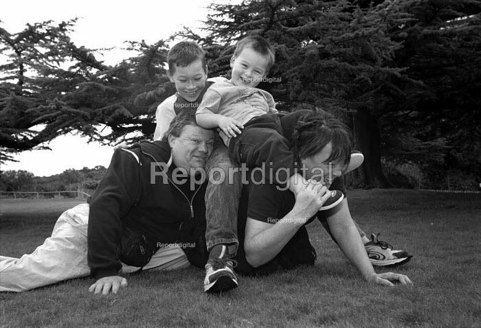 Family playing. - Paul Carter - 2001-09-13