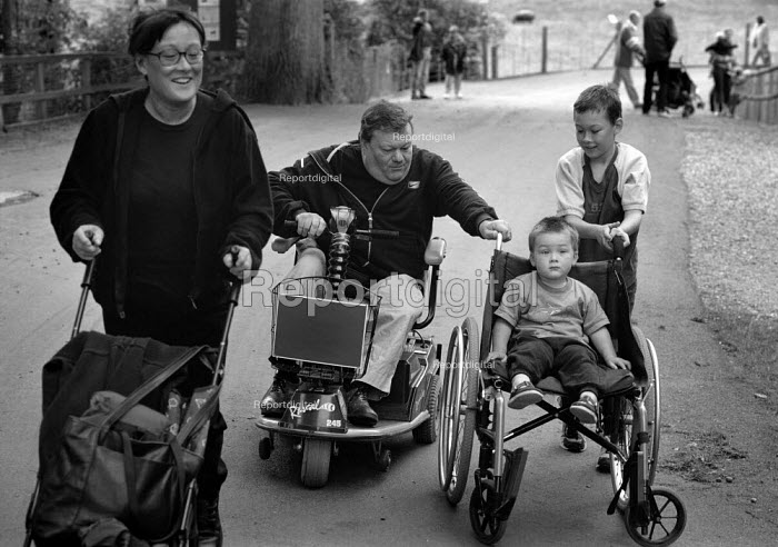 Family during a day out at a zoo. The father is using a motorised chair while his clidren use is wheelchair. - Paul Carter - 2001-09-13