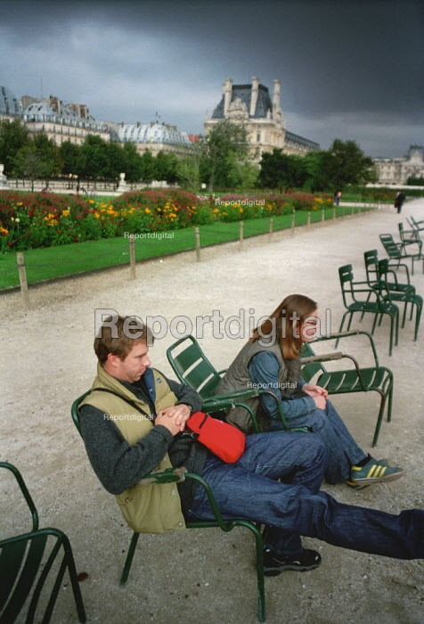 Couple relaxing on chairs in a park. - Paul Carter - 2001-09-23